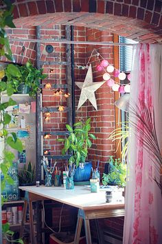 mae's studio has always been one of my favourites - I dream of wood floors and brick walls and green plants and large windows and twinkle lights...