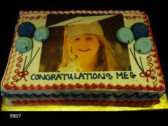 Graduation cake with blue balloons and edible picture on top