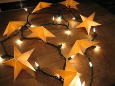 DIY Star Light Minis by b_light: Made of manila folders! DIY Star_Light b_light Christmas Lights, Christmas Crafts, Christmas Decorations, Homecoming Decorations, Holiday Lights, Xmas, Eid Decorations, Homemade Decorations, Christmas Stars
