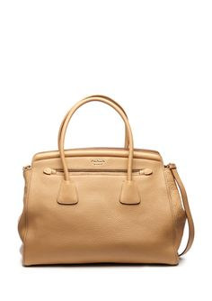 A nude leather tote is the perfect work wardrobe addition.
