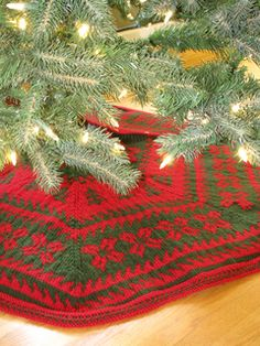 Wrap your Holiday Tree in this festive color work tree skirt, featuring Latvian braided trim.