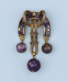 AN ANTIQUE AMETHYST, PEARL AND DIAMOND BROOCH -  Designed as a horse-shoe shaped body set with calibrated amethysts, partly interspersed with pearl and diamond set stars, the centre with rope tied gold thread strung with two diamond set crown slides, supporting three amethyst spheres encrusted with rose-cut diamond set four-leaf clover appliques, circa 1870