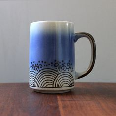 Sharpie project? Etsy listing at http://www.etsy.com/listing/178816821/vintage-rustic-stoneware-mug-blue-wave