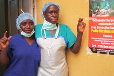 Staff members at a hospital in Nigeria, where Indian Rotarians performed corrective surgery on 400 children crippled by polio, make the This Close sign.     Photo by Charanjit Singh