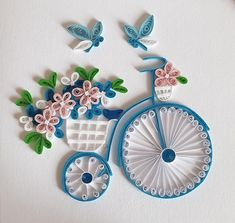 High wheel quilling card. 100% handmade with quilling technique made of narrow paper strips (approx. 2 mm wide) This is a nice greeting or congratulation card and an ideal gift for people who love quilling products and like to balance with the high wheel. Scope of delivery: Quilling card, envelope,