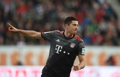 Bayern Munich's Polish striker Robert Lewandowski celebrates after his first goal for Munich during the German first division Bundesliga football match between FC Augsburg and FC Bayern Munich in Augsburg, southern Germany, on October 29, 2016. / AFP / CHRISTOF STACHE / RESTRICTIONS: DURING MATCH TIME: DFL RULES TO LIMIT THE ONLINE USAGE TO 15 PICTURES PER MATCH AND FORBID IMAGE SEQUENCES TO SIMULATE VIDEO. == RESTRICTED TO EDITORIAL USE == FOR FURTHER QUERIES PLEASE CONTACT DFL DIRECTLY AT…