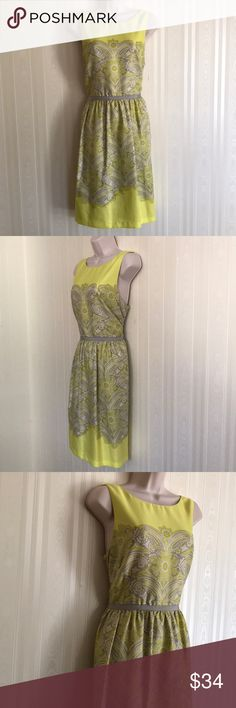 LOFT lemony/lime patterned dress NEVER WORN This dress is beautiful and unique.  A very pretty yellow/green color with lovely patterns, you're sure to be noticed while wearing this.  Silky and sexy, 100% polyester.  Never worn.  Don't miss! LOFT Dresses
