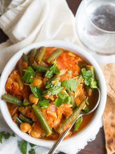 Green beans, tomatoes, almonds and chickpeas are simmered up in a lightly spiced tomato base to make this Lebabese green bean stew, also known as loubieh.