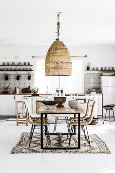 boho eat in kitchen area woven hanging shade shag rug open shelves white cabinets