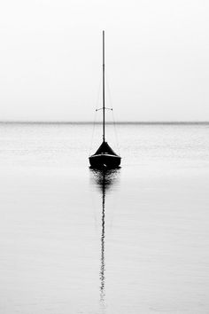 I adore black and white photography. There is such an innocence to it that covers all of the colorful flaws of a colored image. The asymmetrical line that is created in this image by the boats sail and water reflection is what caught my eye. Black White Photos, Black N White, Black And White Photography, Ligne D Horizon, Minimalist Photography, Belle Photo, Monochrome, Reflection, Sailing