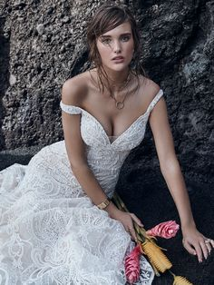 Sottero and Midgley - ELIAS, For your true-blue, unabashedly feminine, and sensual soul, this beaded lace mermaid wedding dress delights with delicate off-the-shoulder sleeves, shimmery motifs, and gorgeous illusion details.