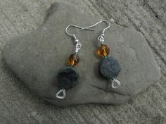 Check out this item in my Etsy shop https://www.etsy.com/listing/245559803/green-stone-and-amber-glass-earring-with