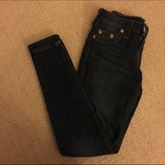 Dark wash skinny True Religion jeans Very soft, jegging-like material. Size 24 but fits almost like a 25. I would say they would work for both sizes. Skinny cut. Authentic and very comfortable True Religion Jeans Skinny