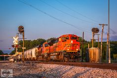 https://flic.kr/p/H8ihv3 | Westbound BNSF Special Unit Train at Atherton, MO | Passing the Ex-ATSF 431 searchlight signals at Atherton-Sibley Road on the BNSF Marceline Sub. is a loaded sand move, BNSF Train U EOLSOX0 10T. Rear end DPU's were BNSF 7085 and BNSF 4487. Locomotives: BNSF 8565, BNSF 7123 5-17-16 Atherton, MO
