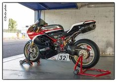 Race prepared 1198. (ducati cafe, fb). Ducati Corse name and flag icon.