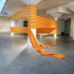 Brooklyn-based artist Rebecca Ward uses electrical tape with vinyl adhesives to create visually exciting installations. Her site-specific geometric creations work as an extension to its surrounding architecture.