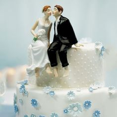 The Picture of Wedded Bliss in a Hand Painted porcelain wedding cake top. This relaxed, barefoot couple will make all your guests smile as they watch the bride and groom lean in for a kiss! Note: Due