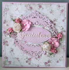 Et kort lagd med nye dies fra Papirdesign. Det er ellers brukt en rekke blomster og chipboard.