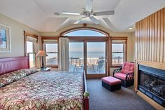 A beautiful master bedroom with a fireplace and ocean views! Wow! The Beach House 407