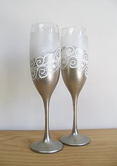 Beautiful hand- painted set of champagne Wedding glasses. Elegant diagonal painting in silver, white and frosted glass.  These Champagne