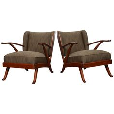 Pair of 1940 Mid-Century English Mahogany Armchairs   From a unique collection of antique and modern armchairs at https://www.1stdibs.com/furniture/seating/armchairs/