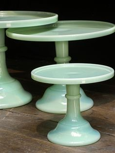 LOVE Jadeite cake stands, but they would look really cool stacked alternating with clear glass stands in a similarly simple pattern.