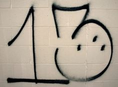 Surenos 13, a Hispanic gang, will often tag areas with '13,' 'Sur 13' or 'X3.' The three dots forming a pyramid within the three symbolize 'My Crazy Life -- Hospital, Prison or Cemetery.'