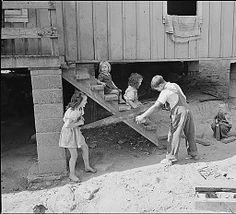 Children playing. Some of the houses were jacked up and cinder block foundation posts installed several years ago. Panther Red Ash Coal Corporation, Douglas Mine, Panther, McDowell County, West Virginia., 08/26/1946