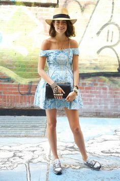 Leandra Medine of the Man Repeller in a light blue mini dress, Valentino shoulder bag, New Balance sneakers and lots of jewelry.