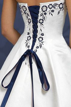 Navy Blue and Silver! This White Satin gown is embroidered with Navy Blue and silver threads. It laces up the back with a navy blue satin lace up. This also makes the gown very adjustable. Style being discontinued, this is the LAST ONE! SIZE RANGE 4 6 8 New HALTER or Strapless Wedding dress Navy Blue SALE IN STOCK