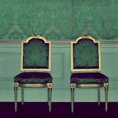 Silvered side chairs with emerald green damask.