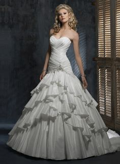 Mys best friend's wedding dress by Maggie Sottero! Beautiful and it doesn't hurt that it's named Jenna )