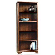 Cherry finish Five shelves (four adjustable) provide ample storage for books, photos & collectibles Easy to assemble Made in the U.S.A.