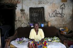 A woman sits in front of her home, once occupied by Boko Haram, in Michika May 10, 2015. REUTERS/Akintunde Akinleye