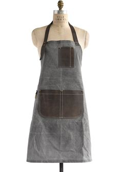 """From the Bailey Utility collection, inspired by rugged American tradition. The """"Peyton"""" style is made of waxed heavyweight cotton canvas with a distinct """"grid"""" pattern, and trimmed with heavy-duty saddle leather. Our classic bib style apron is roomy enough for both men & women. Available in four colors: Slate (featured here); Olive; Jet; and Blaze […]"""