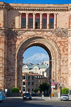Armenian architecture with view through arch of Mount Ararat in the distance, at the Hanrapetutyan Hraparak (Republic Square), Yerevan, Armenia, Caucasus, Central Asia, Asia