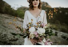 Long white dress with open back and a natural bouquet | Photography: Dearheart Photos | Flowers & decor: The Holloway Shop | Dress: Bo and Luca | Venue: The Modern Heirloom | Hair & make-up: Nadia Professional Hair and Makeup