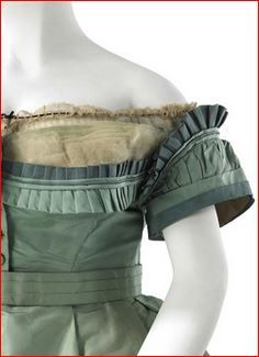 House of Worth. Garment details: The pleated trims on the evening bodice are particularly creative. Most of the pleats are simple knife pleats with a few stand-up box pleats at the top of the sleeves. 1864-67. MCNY Collections.