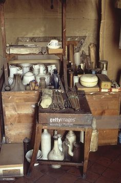 Italian painter Giorgio Morandi's tools at his atelier on via Fondazza 36. On a stool, some brushes and the bottles he used for still life paintings. Bologna, April 1950s