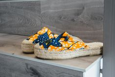 This mules are the ethnic chic version of the classic espadrilles sandals, inspired in Africa and handmade in Spain with quality materials.  #espadrilles # ethnic #orange  #blue #mules #shoes #sandals #artisan #jute #slowfashion #handmade #handmadeshoes #sustainable #semba #outfit #streetstyle #ss18 #newcollection #comfy #ecochic #africanprint #pattern #waxprint #fabric #design #chimamanda Mule Sandals, Espadrille Sandals, Mules Shoes, Espadrilles, Shoes Sandals, Ethnic Chic, Orange Pattern, Slow Fashion, Jute