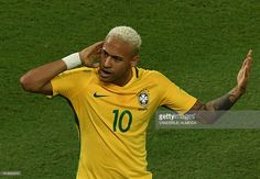 News Photo : Brazil's Neymar celebrates after scoring against...