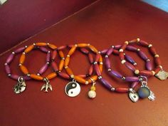 Pillow Bead Bracelets with Charms by VintageMirageJewelry on Etsy