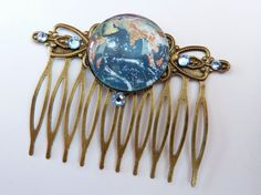 Elegant hair comb in bronze with planet Earth motif, world hair comb