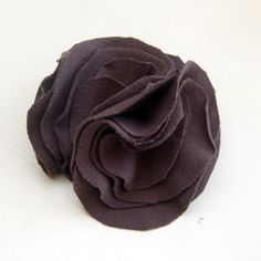 DIY easy fabric flower, make into a clip, barette, embelishment or add to a t-shirt!