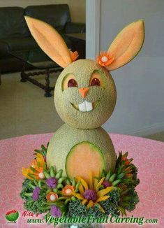 Easter Bunny Centerpiece Carved from Cantaloupe. Get details about the ingredien… Easter Bunny Centerpiece Carved from Cantaloupe. Get details about … L'art Du Fruit, Deco Fruit, Fruit Art, Kids Fruit, Easter Bunny Centerpiece, Fruits Decoration, Deco Buffet, Fruit Creations, Fruit And Vegetable Carving
