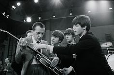 Ed Sullivan receives some guitar lessons from Paul McCartney in between rehearsals at CBS televisi...