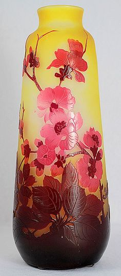 Emile Gallé Apple Blossom Cameo Vase from 1900. He was known for his Cameo glass, this was the process where the glass is etched and craved through fused layers of colour glass. The colours in this particular glass vase were rare at the time.