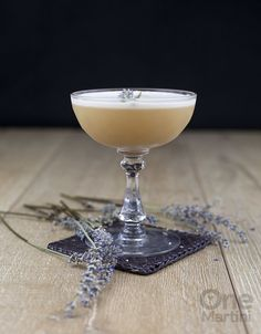 Lady Jane: earl grey infused gin, lavender simple syrup, lemon juice, egg white