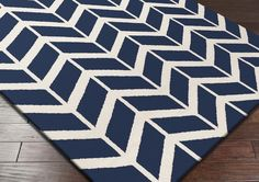 Surya Fallon FAL-1093 Area Rug From delicate lattice patterns to boldly colored chevron patterns the Fallon Collection makes a statement in flat weave; from creator Jill Rosenwald known for her beautifully colored, hand-made ceramics.