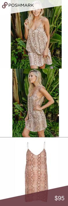 NWT Acacia Flores Mini Dress- Python NWT Acacia Swimwear Flores Mini Dress- Python. V-neckline, fixed spaghetti straps, low scoop back. 100% Silk acacia swimwear Dresses Mini
